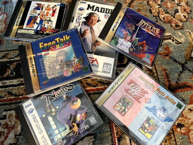 A pile of Saturn games on the floor